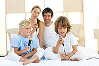 Animated family singing together sitting on bed