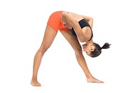 Athletic woman in sportswear bending and stretching