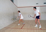 Man and woman playing racquetball