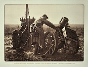 Soldier looking at Germen captured mortars / cannons at battlefield in Flanders during the First World War, Belgium