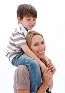 Close_up of mother giving son piggy back ride against white background