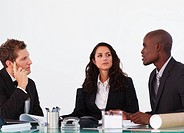 Three business people interacting to each other in a meeting