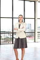 Serious businesswoman standing in an office looking at the camera