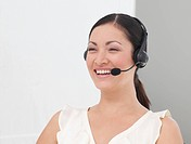 International Business woman on a Headset smiling