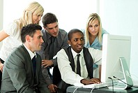 Ethnic business team working in office together