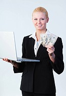 Young attractive woman holding dollars and a laptop