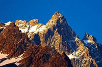 France, Rhône-Alpes, The Ecrins National Park  Morning light illuminates the peak of La Meije, within the Ecrins National Park near the village of La ...