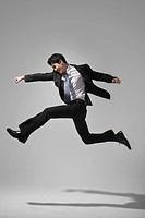 Businessman jumping in Studio