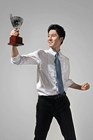 Businessman Holding a Trophy