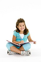 Child working on homework on white background