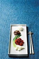 vegetable on plate with chopstick