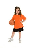 Caucasian child in a basketball uniform holding a ball