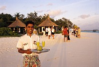 Waiter with cocktails on the beach, Hotel Banyan Tree Spa, Vabbinfaru, Maledives, Indian Ocean