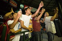 Spectators applauding during a Thai boxing competition, Lumphini Stadium, Bangkok, Thailand