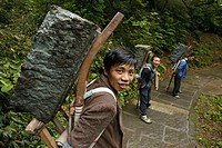 path and stairs, porters with heavy stone load, mountains, Emei Shan, World Heritage Site, UNESCO, China, Asia