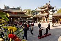 People at the courtyard of Nanputuo temple, Xiamen, Fujian province, China, Asia