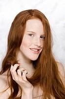 young woman looking at hair ending