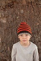 Freckled boy in striped beanie