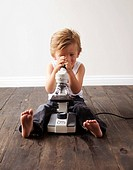 Young boy looking through microscope