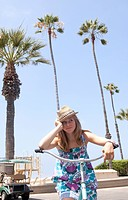 Teenage girl on bike near the beach