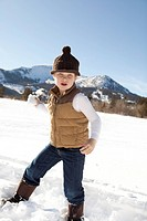 Young boy making snowballs