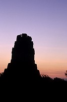 Sunrise over Mayan ruins of Temple I, Temple of the Grand Jaguar, in the Great Plaza of UNESCO World Heritage site of Tikal- Tikal National Park, Guat...
