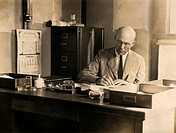 Wilbur A. Sawyer 1879_1951, US medical researcher, at the village office of the Yellow Fever Laboratory in Yaba, Nigeria. Sawyer, an expert in tropica...