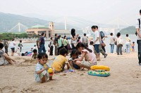 People at the Park Island beach, Ma Wan, Hong Kong