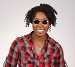 Young African-American woman with sunglasses posing for portrait
