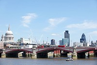 England, London, City of London, View of Blackfriars Bridge with a red bus and the City of London providing the backdrop.