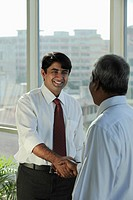Indian man shaking hands and smiling