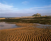 England, Northumberland, Bamburgh, A view to Bamburgh Castle from the foreshore.