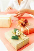 Person gift wrapping presents