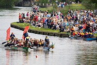 Dragon boat racing at the annual fund raising event on the River Thames at Abingdon. Dragon Boat racing is a Chinese tradition dating back over 2000 y...