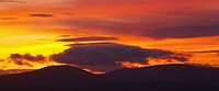 England, Northumberland, Northumberland National Park, Northumberland National Park. A spectacular sunset over the Cheviot Hills, viewed from Ros Cast...