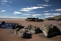 Scotland, Aberdeenshire, St Cyrus, Large rocks on St Cyrus beach at low tide in Aberdeenshire.