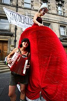 Scotland, Midlothian, Edinburgh, Performers advertising their play in The Royal Mile in the Old Town of Edinburgh during the Fringe Festival
