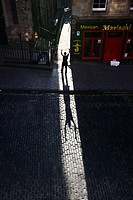 Scotland, Midlothian, Edinburgh, A man silhouetted in Victoria Sreet in the Old Town of Edinburgh