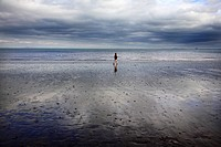 Scotland, City of Edinburgh, Edinburgh, A man walking on Portobello beach in Edinburgh