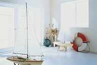 Ship model and nautical equipment in room