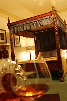 Brandy Glasses in hotel room with a four poster bed