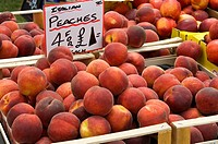 England, North Yorkshire, _, Fresh peaches for sale on a market stall.