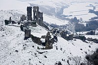 England, Dorset, Corfe Castle, Corfe Castle and village after a Snow Blizzard in March 2009.