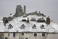 England, Dorset, Corfe Castle, The Greyhound pub, one of the most photographed pubs in England, in winter snow below Corfe Castle