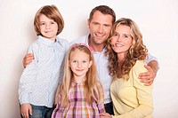 Germany, Cologne, Family embracing, smiling, portrait, close_up