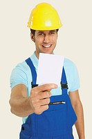 Man wearing hard hat holding blank paper, close_up, portrait