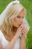 Bride kissing her wedding ring.