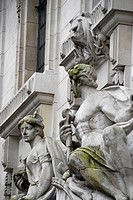 England, London, The City, Stone statues of a man and woman on the exterior of the Old Bailey.