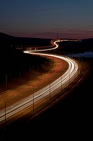 England, West Yorkshire, Huddersfield, The Trans_Pennine section of the M62 at night. It was opened by the Queen in 1971 and remains the highest motor...
