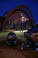 England, South Yorkshire, Sheffield, The Winter Garden and polished chromed spheres water feature at night